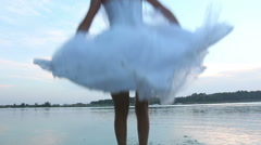 Jump into the water in a wedding dress Stock Footage
