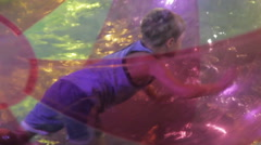 Child playing in the water park on the water, HD 1080p Stock Footage