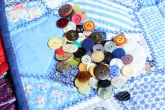 Lot of buttons placed on a quilting Stock Photos