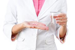 Medicines in hand close-up Stock Photos
