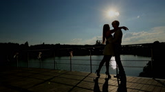 Lovers kissing at sunset Stock Footage
