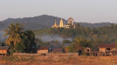 Passing a village with temple on the hill,Irrawaddy,Burma Stock Footage