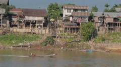 Small boat tracking on the Irrawaddy,Irrawaddy,Burma Stock Footage