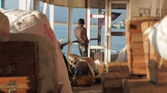 Man looks at view on Slow boat with cargo,Irrawaddy,Burma Stock Footage