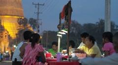People eating noodle soup at Shwemawdaw Paya,Bago,Burma Stock Footage