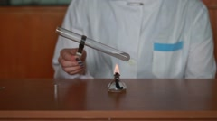 Warming test-tubes with liquid on a spirit-lamp Stock Footage