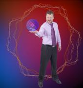 Businessman holding his right hand out,palm up and magic sphere on abstract b - stock photo