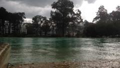 Tropical hard rain storm over lake / pool.  HD Stock Footage