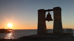 Old  bell on bank of  Black Sea on a sunset, Chersonese, Sevastopol Stock Footage