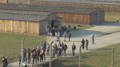 Visiting Auschwitz-Birkenau extermination camp Stock Footage