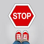 Stop Concept, Person Standing in Front of Sign Stock Illustration