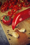 Pepper and Garlic as Hot Food Ingredients for Piquant Cuisine - stock photo