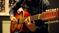 Man Plays Acoustic Guitar and Sings on Beautiful Background Stock Footage