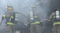 Close Up Firemen With Hose At Smoking Wreckage 02 Stock Footage