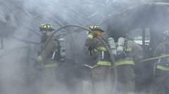 Close Up Firemen With Hose At Smoking Wreckage 01 Stock Footage