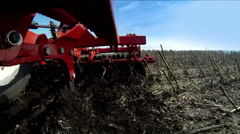 Tractor handles field. Disking. Stock Footage