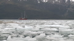 Moving Ice, Land of Fire, sea, boat, long shot Stock Footage