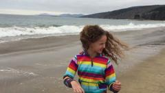 Little Girl, swinging head / hear - super slow motion. At the beach HD Stock Footage