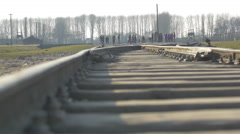 Tourists at the railway in Auschwitz Stock Footage