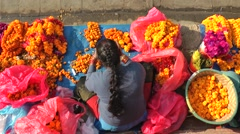Lady makes flower necklaces on Durbar square,Kathmandu,Nepal - stock footage