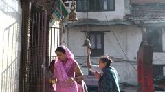 Devotees ring bells on Durbar square,Kathmandu,Nepal Stock Footage