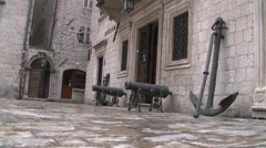 Big iron anchor and irond cannons at Old  City Kotor full HD Stock Footage