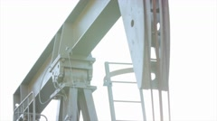 An oil rig head pumping oil from well Stock Footage
