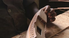 Man produces wooden ship model in a workshop in Curepipe, Mauritius. Stock Footage