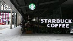 Starbucks Coffee coffeehouses on Orchard Road in Singapore - stock footage