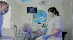 tooth dentist examines the camera - stock footage