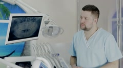 Stock Video Footage of Dentist near the monitor , the monitor renhen