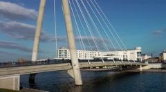 Suspension bridge Southport blue sky movement modern hotel Stock Footage
