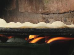 Traditional thin pitta bread being cooked at the gas stove. Stock Footage