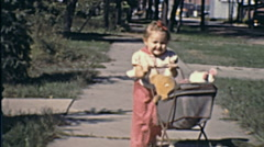 USA 1941: baby girl playing with a toy trolley - stock footage