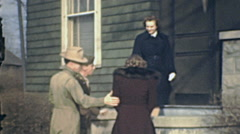 USA 1941: group of people entering into home Stock Footage