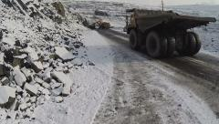Truck is driving in quarry in winter Stock Footage