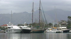 Luxury yachts and sail ships at port Stock Footage
