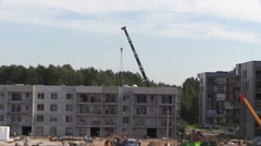 Intensive construction site works. Workers and cranes. Stock Footage