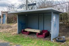 Bus stop in the village with furniture Stock Photos
