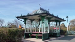Victorian seaside shelter decorative roof bench architecture cast iron Stock Footage