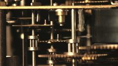 Stock Video Footage of Cogwheels of an antique clock, macroshot of the working mechanism