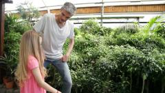 Father watching plants with her little daughter - stock footage