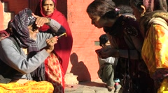 Woman gets Tilaka forehead mark temple,Patan,Nepal - stock footage