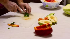 Cooking salad, Man slicing  cucumber for vegetable salad Stock Footage