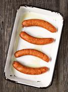 tray of rustic uncooked sausages - stock photo
