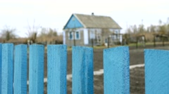House behind a wooden fence Stock Footage