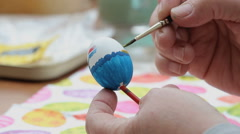 Painting a Easter Egg. Close up of womand hands Stock Footage
