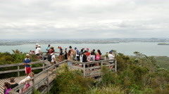 Tourists looking from Rangitoto island to Auckland Stock Footage
