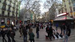 Stock Video Footage of People at the crowded La Rambla street at the heart of Barcelona, Spain.