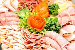 Meat sausage slices assortment on Party Plate - stock photo